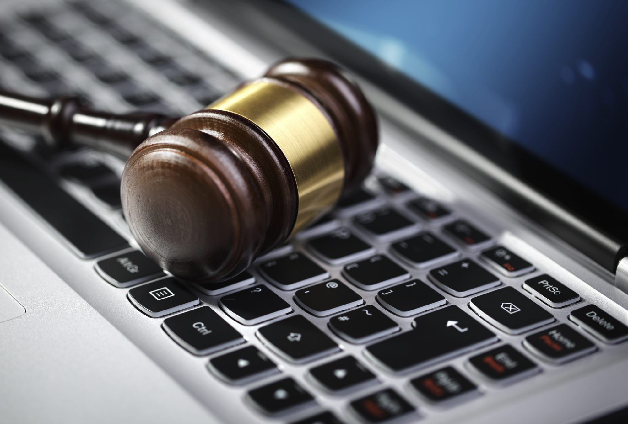 Justice gavel on top of a computer